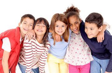 Group of children hugging & smiling l Burien Dental Clinic Burien WA